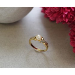Bague en or jaune et perle