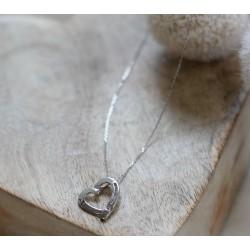 Collier coeur en or blanc et diamants