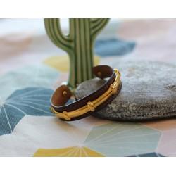 Bracelet Hermès Vintage en cuir et plaqué or.