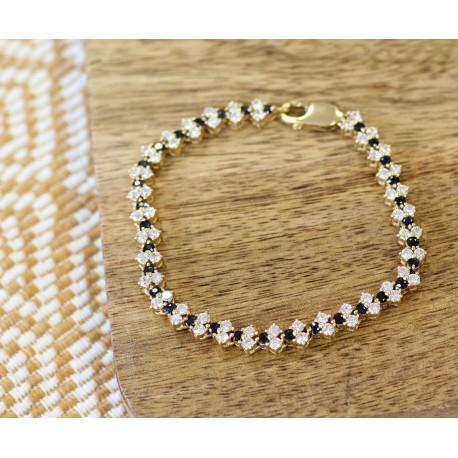 Bracelet en or jaune rivière d' Oxydes et Saphir
