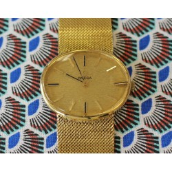 Montre Omega en or jaune 18k