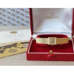 Montre Omega en or jaune 18k