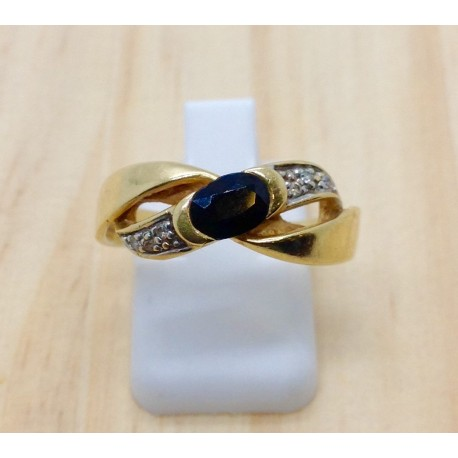 Bague or jaune diamants et pierre bleue