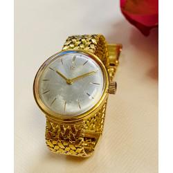 Montre Eterna Matic en or jaune